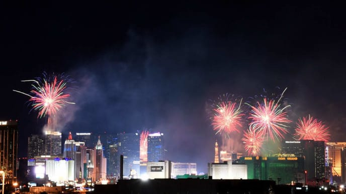 """LAS VEGAS, NEVADA - JANUARY 01:  Fireworks illuminate the skyline over the Las Vegas Strip during an 8-minute-long pyrotechnics show put on by Fireworks by Grucci titled """"America's Party"""" during a New Year's Eve celebration on January 1, 2019 in Las Vegas, Nevada. An estimated 318,000 visitors gathered to watch more than 80,000 fireworks shoot from the rooftops of hotel-casinos to welcome the new year.  (Photo by Ethan Miller/Getty Images)"""