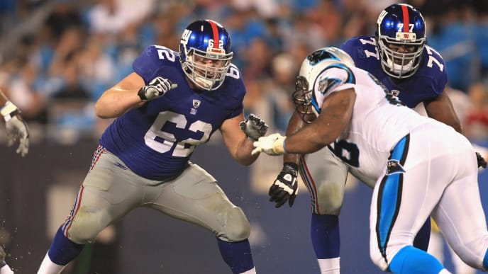 CHARLOTTE, NC - AUGUST 13:  Mitch Petrus #62 of the New York Giants against the Carolina Panthers during their preseason game at Bank of America Stadium on August 13, 2011 in Charlotte, North Carolina.  (Photo by Streeter Lecka/Getty Images)