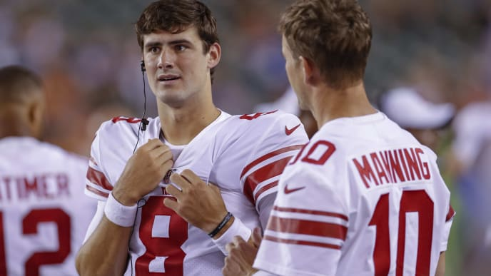 CINCINNATI, OH - AUGUST 22: Daniel Jones #8 and Eli Manning #10 of the New York Giants talk during the preseason game against the Cincinnati Bengals at Paul Brown Stadium on August 22, 2019 in Cincinnati, Ohio. (Photo by Michael Hickey/Getty Images)