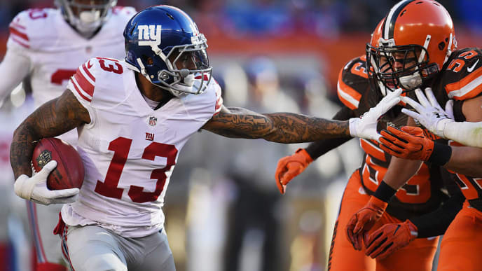 CLEVELAND, OH - NOVEMBER 27:  Odell Beckham #13 of the New York Giants carries the ball in front of Tank Carder #59 of the Cleveland Browns during the third quarter at FirstEnergy Stadium on November 27, 2016 in Cleveland, Ohio. (Photo by Jason Miller/Getty Images)