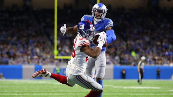 DETROIT, MICHIGAN - OCTOBER 27: Darius Slayton #86 of the New York Giants catches a second quarter touchdown in front of Rashaan Melvin #29 of the Detroit Lions at Ford Field on October 27, 2019 in Detroit, Michigan. (Photo by Gregory Shamus/Getty Images)