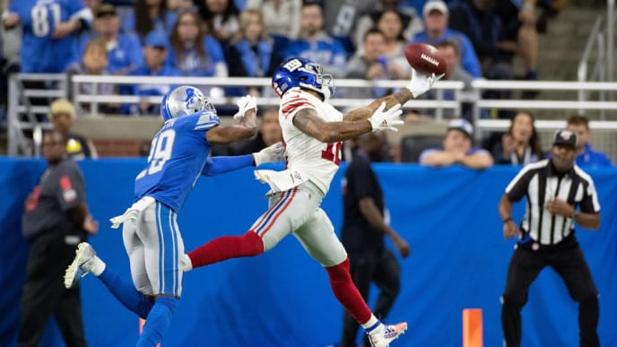 DETROIT, MI - OCTOBER 27: Cody Latimer #12 of the New York Giants makes the touchdown catch as Rashaan Melvin #29 of the Detroit Lions defends during the fourth quarter of the game at Ford Field on October 27, 2019 in Detroit, Michigan. Detroit defeated New York 31-26.  (Photo by Leon Halip/Getty Images)