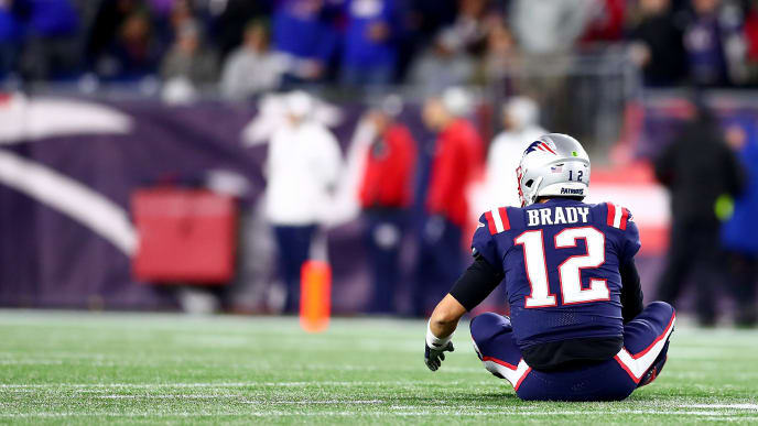 FOXBOROUGH, MASSACHUSETTS - OCTOBER 10: Tom Brady #12 of the New England Patriots reacts from the ground after Markus Golden #44 of the New York Giants recovered a fumble to score a touchdown during the second quarter in the game at Gillette Stadium on October 10, 2019 in Foxborough, Massachusetts. (Photo by Adam Glanzman/Getty Images)
