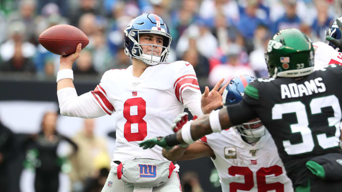 EAST RUTHERFORD, NEW JERSEY - NOVEMBER 10:  Daniel Jones #8 of the New York Giants passes against the New York Jets during their game at MetLife Stadium on November 10, 2019 in East Rutherford, New Jersey. (Photo by Al Bello/Getty Images)