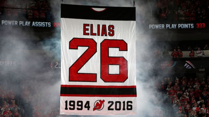NEWARK, NJ - FEBRUARY 24: Former New Jersey Devil Patrik Elias #26 jersey is lifted during a retirement ceremony prior to a game against the New York Islanders at the Prudential Center on February 24, 2018 in Newark, New Jersey. (Photo by Adam Hunger/Getty Images)
