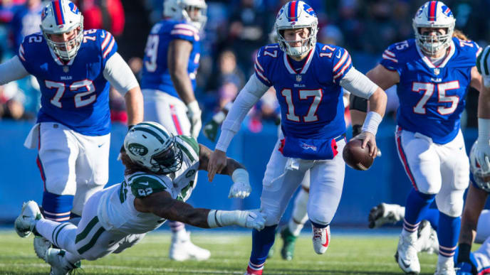 ORCHARD PARK, NY - DECEMBER 09:  Josh Allen #17 of the Buffalo Bills escapes a tackle by Leonard Williams #92 of the New York Jets while carrying the ball during the first quarter at New Era Field on December 9, 2018 in Orchard Park, New York.  (Photo by Brett Carlsen/Getty Images)