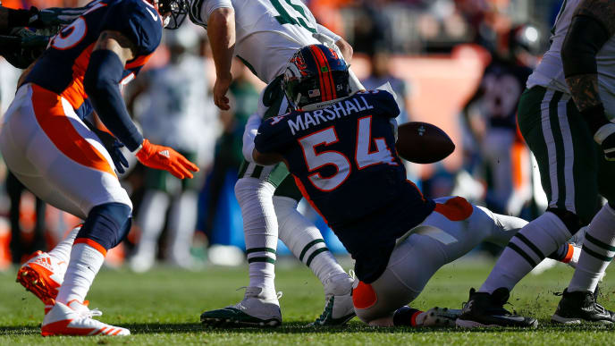 DENVER, CO - DECEMBER 10:  Inside linebacker Brandon Marshall #54 of the Denver Broncos sacks quarterback Josh McCown #15 of the New York Jets and forces a fumble during the first quarter at Sports Authority Field at Mile High on December 10, 2017 in Denver, Colorado. (Photo by Justin Edmonds/Getty Images)