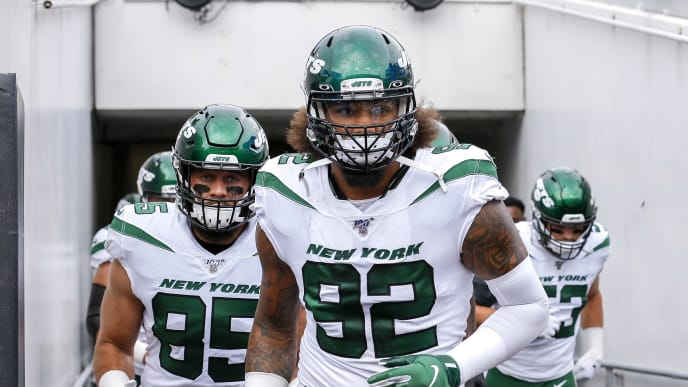 JACKSONVILLE, FL - OCTOBER 27: Defensive tackle Leonard Williams #92 and tight end Trevon Wesco #85 of the New York Jets run into the stadium before the game against the Jacksonville Jaguars at TIAA Bank Field on October 27, 2019 in Jacksonville, Florida. The Jaguars defeated The Jets 29 to 15. (Photo by Don Juan Moore/Getty Images)