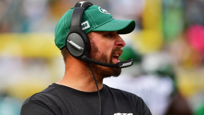JACKSONVILLE, FLORIDA - OCTOBER 27: Head coach Adam Gase of the New York Jets  talks on his headset during the third quarter of a football game at TIAA Bank Field on October 27, 2019 in Jacksonville, Florida. (Photo by Julio Aguilar/Getty Images)