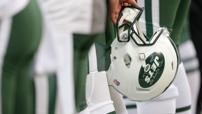 KANSAS CITY, MO - SEPTEMBER 25: A New York Jets helmet is held behind a player's back during the national anthem before NFL action against the Kansas City Chiefs at Arrowhead Stadium before the game on September 25, 2016 in Kansas City, Missouri. (Photo by Jamie Squire/Getty Images)