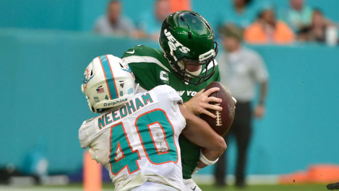 MIAMI, FL - NOVEMBER 03: Nik Needham #40 of the Miami Dolphins sacks Sam Darnold #14 of the New York Jets during the fourth quarter of the game at Hard Rock Stadium on November 3, 2019 in Miami, Florida. (Photo by Eric Espada/Getty Images)