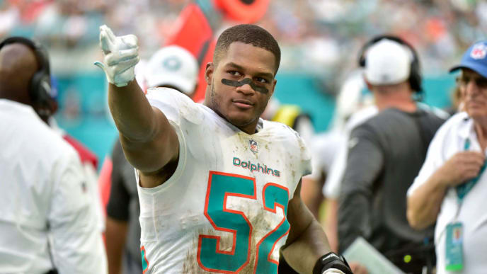 MIAMI, FL - NOVEMBER 03: Raekwon McMillan #52 of the Miami Dolphins makes a first down signal during the fourth quarter of the game against the New York Jets at Hard Rock Stadium on November 3, 2019 in Miami, Florida. (Photo by Eric Espada/Getty Images)