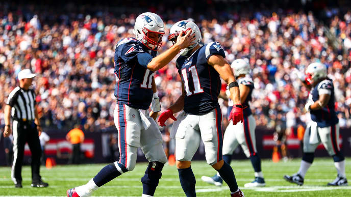 FOXBOROUGH, MA - SEPTEMBER 22: Julian Edelman #11 high fives Tom Brady #12 of the New England Patriots after a touchdown in the second quarter of a game against the New York Jets at Gillette Stadium on September 22, 2019 in Foxborough, Massachusetts.  (Photo by Adam Glanzman/Getty Images)