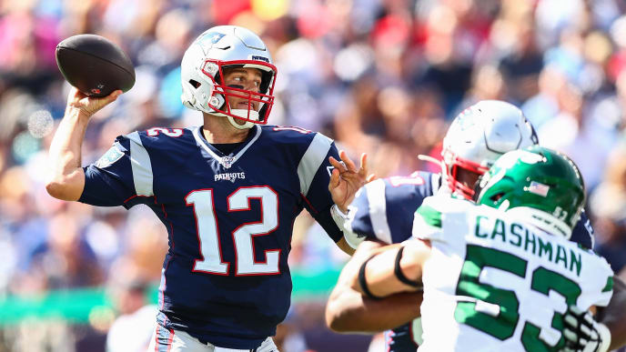 FOXBOROUGH, MA - SEPTEMBER 22:   Tom Brady #12 of the New England Patriots throws the ball under pressure during a game against the New York Jets at Gillette Stadium on September 22, 2019 in Foxborough, Massachusetts.  (Photo by Adam Glanzman/Getty Images)