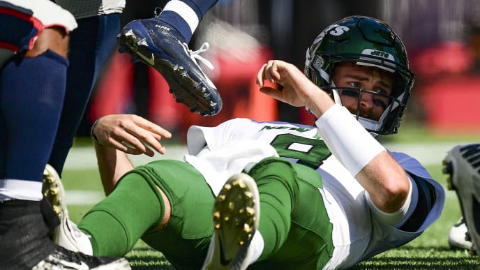 FOXBOROUGH, MA - SEPTEMBER 22: Luke Falk #8 of the New York Jets reacts after being sacked during the first quarter of a game against the New England Patriots at Gillette Stadium on September 22, 2019 in Foxborough, Massachusetts. (Photo by Billie Weiss/Getty Images)