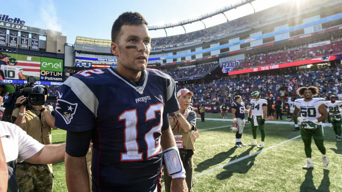 FOXBOROUGH, MA - SEPTEMBER 22: Tom Brady #12 of the New England Patriots runs off the field after a game against the New York Jets at Gillette Stadium on September 22, 2019 in Foxborough, Massachusetts. (Photo by Billie Weiss/Getty Images)