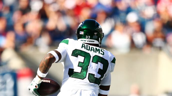 FOXBOROUGH, MASSACHUSETTS - SEPTEMBER 22: Jamal Adams #33 of the New York Jets runs with the ball after making an interception against the New England Patriots at Gillette Stadium on September 22, 2019 in Foxborough, Massachusetts. (Photo by Adam Glanzman/Getty Images)