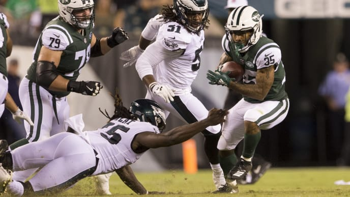 PHILADELPHIA, PA - AUGUST 30: Charcandrick West #35 of the New York Jets runs the ball against Josh Sweat #75 of the Philadelphia Eagles in the second quarter during the preseason game at Lincoln Financial Field on August 30, 2018 in Philadelphia, Pennsylvania. (Photo by Mitchell Leff/Getty Images)