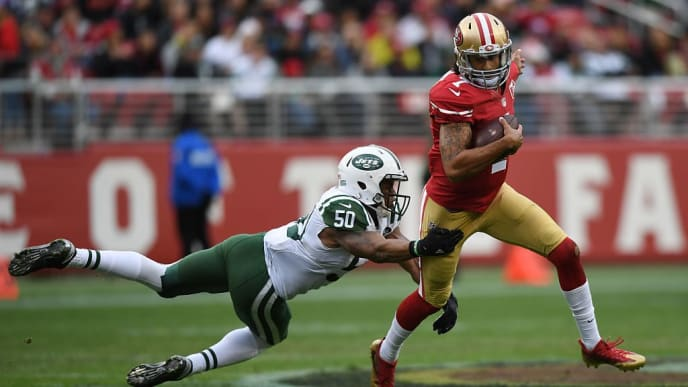 SANTA CLARA, CA - DECEMBER 11:  Colin Kaepernick #7 of the San Francisco 49ers breaks a tackle by Darron Lee #50 of the New York Jets during their NFL game at Levi's Stadium on December 11, 2016 in Santa Clara, California.  (Photo by Thearon W. Henderson/Getty Images)