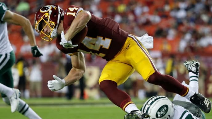 LANDOVER, MD - AUGUST 16: Wide receiver Trey Quinn #14 of the Washington Redskins is tackled by wide receiver Charone Peake #17 of the New York Jets as he returns a punt in the third quarter of a preseason game at FedExField on August 16, 2018 in Landover, Maryland. (Photo by Patrick McDermott/Getty Images)