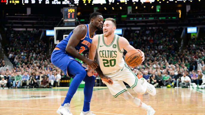 BOSTON, MA - NOVEMBER 1: Gordon Hayward #20 of the Boston Celtics drives past Julius Randle #30 of the New York Knicks the second half at TD Garden on November 1, 2019 in Boston, Massachusetts. NOTE TO USER: User expressly acknowledges and agrees that, by downloading and or using this photograph, User is consenting to the terms and conditions of the Getty Images License Agreement. (Photo by Kathryn Riley/Getty Images)