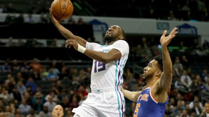 CHARLOTTE, NC - DECEMBER 18:  Kemba Walker #15 of the Charlotte Hornets drives to the basket against Courtney Lee #5 of the New York Knicks during their game at Spectrum Center on December 18, 2017 in Charlotte, North Carolina.  NOTE TO USER: User expressly acknowledges and agrees that, by downloading and or using this photograph, User is consenting to the terms and conditions of the Getty Images License Agreement.  (Photo by Streeter Lecka/Getty Images)