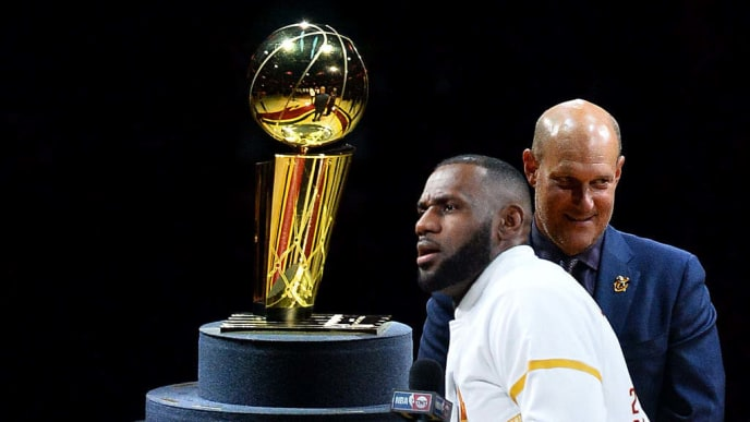 CLEVELAND, OH - OCTOBER 25: LeBron James #23 of the Cleveland Cavaliers speaks in front of the Larry O'Brien Trophy after receiving his championship ring before the game against the New York Knicks at Quicken Loans Arena on October 25, 2016 in Cleveland, Ohio.  (Photo by Jamie Sabau/Getty Images)