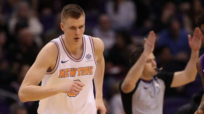 PHOENIX, AZ - JANUARY 26:  Kristaps Porzingis #6 of the New York Knicks reacts after a three point shot against the Phoenix Suns during the second half of the NBA game at Talking Stick Resort Arena on January 26, 2018 in Phoenix, Arizona. NOTE TO USER: User expressly acknowledges and agrees that, by downloading and or using this photograph, User is consenting to the terms and conditions of the Getty Images License Agreement.  (Photo by Christian Petersen/Getty Images)