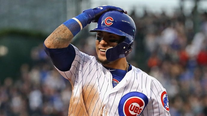 CHICAGO, ILLINOIS - JUNE 20: Javier Baez #9 of the Chicago Cubs smiles after hitting a run scoring triple in the 3rd inning against the New York Mets at Wrigley Field on June 20, 2019 in Chicago, Illinois. (Photo by Jonathan Daniel/Getty Images)