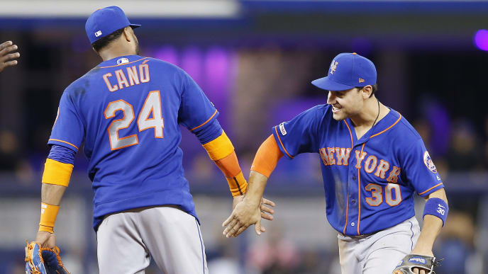 MIAMI, FLORIDA - JULY 13:  Robinson Cano #24 of the New York Mets celebrates with Michael Conforto #30 after they defeat the Miami Marlins 4-2 at Marlins Park on July 13, 2019 in Miami, Florida. (Photo by Michael Reaves/Getty Images)