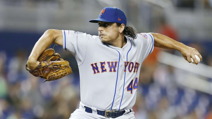 MIAMI, FLORIDA - JULY 12:  Jason Vargas #44 of the New York Mets delivers a pitch against the Miami Marlins during the first inning at Marlins Park on July 12, 2019 in Miami, Florida. (Photo by Michael Reaves/Getty Images)
