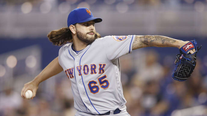 MIAMI, FLORIDA - JULY 14:  Robert Gsellman #65 of the New York Mets delivers a pitch in the ninth inning against the Miami Marlins at Marlins Park on July 14, 2019 in Miami, Florida. (Photo by Michael Reaves/Getty Images)