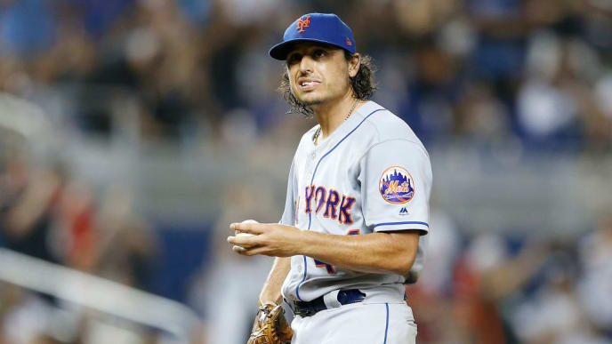 MIAMI, FLORIDA - JULY 12:  Jason Vargas #44 of the New York Mets reacts after giving up a 2-run home run in the third inning against the Miami Marlins at Marlins Park on July 12, 2019 in Miami, Florida. (Photo by Michael Reaves/Getty Images)