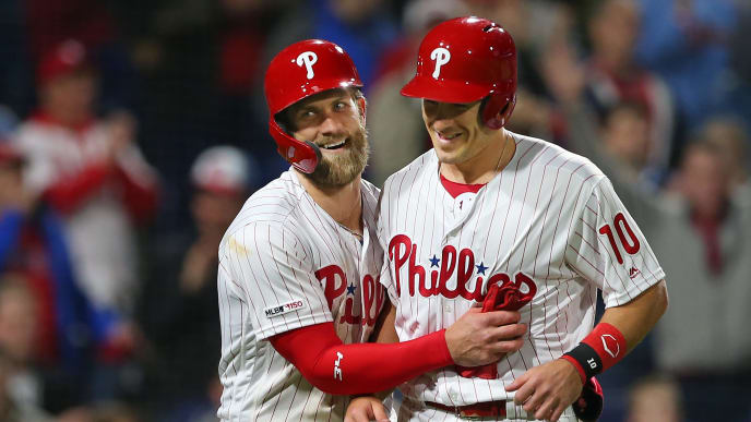 PHILADELPHIA, PA - APRIL 16: Bryce Harper #3 and J.T. Realmuto #10 of the Philadelphia Phillies celebrate after scoring on a double by Scott Kingery #4 against the New York Mets during the sixth inning of a game at Citizens Bank Park on April 16, 2019 in Philadelphia, Pennsylvania. (Photo by Rich Schultz/Getty Images)