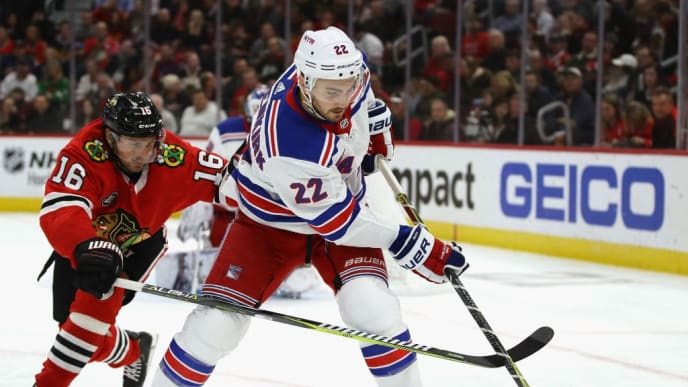CHICAGO, IL - OCTOBER 25:  Kevin Shattenkirk #22 of the New York Rangers controls the puck under pressure from Marcus Kruger #16 of the Chicago Blackhawks at the United Center on October 25, 2018 in Chicago, Illinois. The Blackhawks defeated the Rangers 4-1.  (Photo by Jonathan Daniel/Getty Images)
