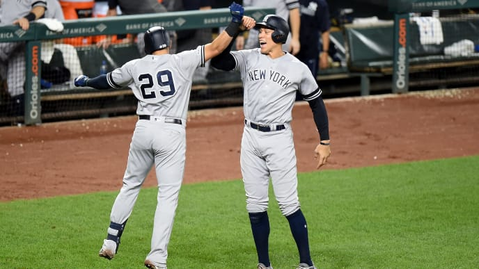 BALTIMORE, MD - AUGUST 07:  Gio Urshela #29 of the New York Yankees celebrates with Aaron Judge #99 after hitting a two-run home run in the sixth inning against the Baltimore Orioles at Oriole Park at Camden Yards on August 7, 2019 in Baltimore, Maryland.  (Photo by Greg Fiume/Getty Images)