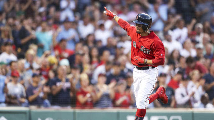 BOSTON, MA - JULY 26:  Mookie Betts #50 of the Boston Red Sox reacts as he returns to the dugout after hitting a solo home run in the third inning of a game against the New York Yankees at Fenway Park on July 26, 2019 in Boston, Massachusetts.  (Photo by Adam Glanzman/Getty Images)