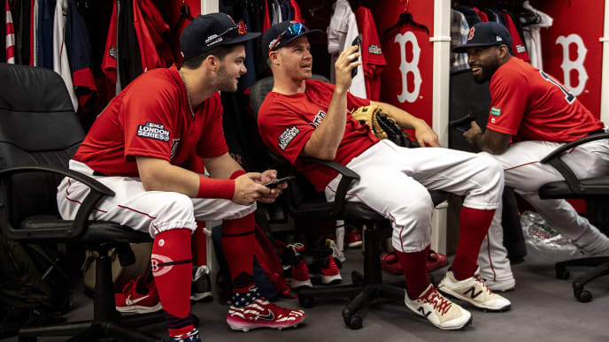 LONDON, ENGLAND - JUNE 30: Andrew Benintendi #16, Brock Holt #12, and Jackie Bradley Jr. #19 of the Boston Red Sox talk in the clubhouse before game two of the 2019 Major League Baseball London Series against the New York Yankees on June 30, 2019 at West Ham London Stadium in London, England. (Photo by Billie Weiss/Boston Red Sox/Getty Images)