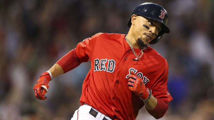 BOSTON, MA - JULY 26:  Mookie Betts #50 of the Boston Red Sox rounds first base after he hits a two-run home run, his third of the game in the fourth inning against the New York Yankees at Fenway Park on July 26, 2019 in Boston, Massachusetts.  (Photo by Adam Glanzman/Getty Images)