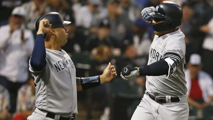 CHICAGO, ILLINOIS - JUNE 15: Gary Sanchez #24 of the New York Yankees congratulates Gleyber Torres following his two run home run during the fourth inning against the Chicago White Sox at Guaranteed Rate Field on June 15, 2019 in Chicago, Illinois. (Photo by Nuccio DiNuzzo/Getty Images)