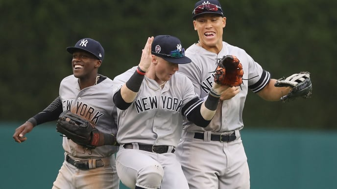 DETROIT, MI - SEPTEMBER 12: Cameron Maybin #38, Clint Frazier #77 and Aaron Judge #99 of the New York Yankees celebrate a win over the Detroit Tigers in game one of a doubleheader at Comerica Park on September 12, 2019 in Detroit, Michigan.  New York defeated Detroit Tigers 10-4. (Photo by Leon Halip/Getty Images)