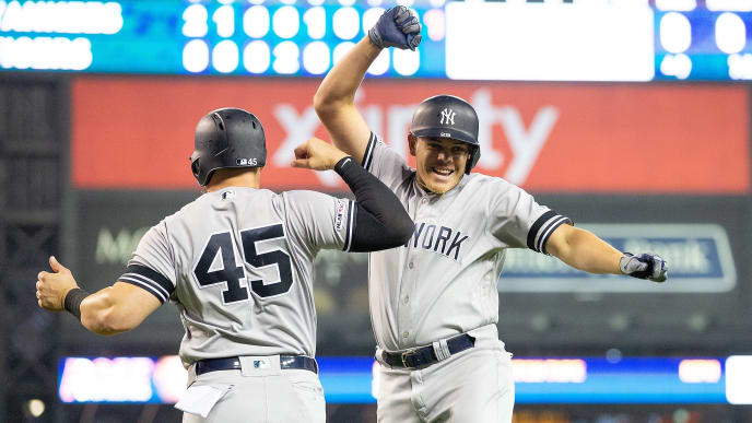 DETROIT, MI - SEPTEMBER 12: Gio Urshela #29 of the New York Yankees celebrates with teammate Luke Voit #45 after hitting a two run home run in the ninth inning of the second game of the doubleheader against the Detroit Tigers at Comerica Park on September 12, 2019 in Detroit, Michigan. (Photo by Leon Halip/Getty Images)