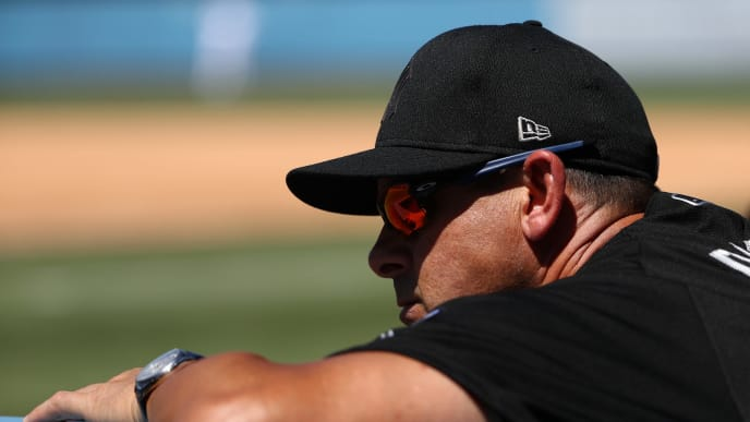 LOS ANGELES, CALIFORNIA - AUGUST 24: Manager Aaron Boone #17 of the New York Yankees looks on from the dugout during the fourth inning of the MLB game against the Los Angeles Dodgers at Dodger Stadium on August 24, 2019 in Los Angeles, California. Teams are wearing special color-schemed uniforms with players choosing nicknames to display for Players' Weekend. (Photo by Victor Decolongon/Getty Images)