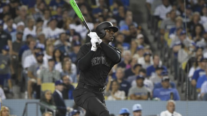 LOS ANGELES, CA - AUGUST 23: Didi Gregorius #18 of the New York Yankees hits a grand slam home run against Hyun-Jin Ryu #99 of the Los Angeles Dodgers in the fifth inning at Dodger Stadium on August 23, 2019 in Los Angeles, California. Teams are wearing special color schemed uniforms with players choosing nicknames to display for Players' Weekend. (Photo by John McCoy/Getty Images)