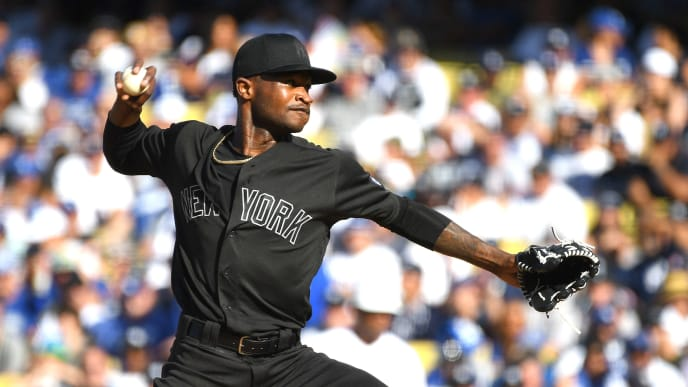 LOS ANGELES, CA - AUGUST 25: Domingo German #55 of the New York Yankees pitches in the first inning of the game against the Los Angeles Dodgers at Dodger Stadium on August 25, 2019 in Los Angeles, California.Teams are wearing special color schemed uniforms with players choosing nicknames to display for Players' Weekend. (Photo by Jayne Kamin-Oncea/Getty Images)