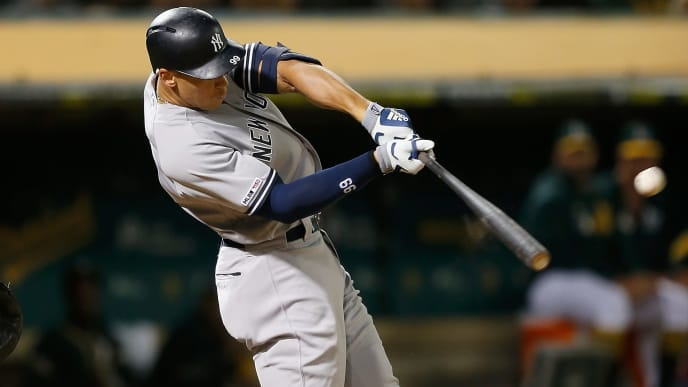 OAKLAND, CALIFORNIA - AUGUST 20: Aaron Judge #99 of the New York Yankees hits a solo home run in the top of the eighth inning against the Oakland Athletics at Ring Central Coliseum on August 20, 2019 in Oakland, California. (Photo by Lachlan Cunningham/Getty Images)