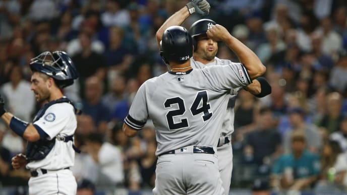 SEATTLE, WA - AUGUST 27:  Gary Sanchez #24 of the New York Yankees greets Brett Gardner #11 after Gardner hit a three-run home run in the third inning at T-Mobile Park on August 27, 2019 in Seattle, Washington. (Photo by Lindsey Wasson/Getty Images)