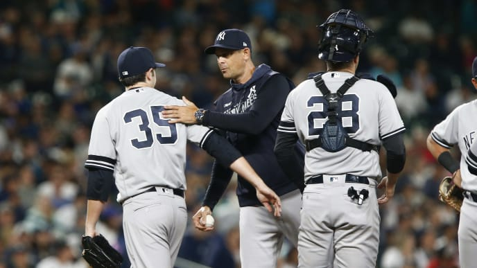 SEATTLE, WA - AUGUST 26:  Cory Gearrin #35 of the New York Yankees is taken out of the game by manager Aaron Boone  in the sixth inning against the Seattle Mariners at T-Mobile Park on August 26, 2019 in Seattle, Washington. (Photo by Lindsey Wasson/Getty Images)