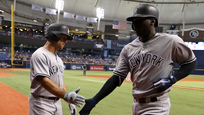 ST PETERSBURG, FL - JULY 24:  Didi Gregorius #18 of the New York Yankees is congratulated after scoring Brett Gardner #11 on a sac fly in the first inning during a game against the Tampa Bay Rays at Tropicana Field on July 24, 2018 in St Petersburg, Florida.  (Photo by Mike Ehrmann/Getty Images)