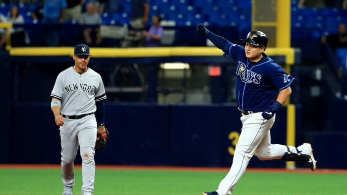 ST PETERSBURG, FLORIDA - SEPTEMBER 24: Ji-Man Choi #26 of the Tampa Bay Rays celebrates a walk off home run in the 12th inning during a game against the New York Yankees at Tropicana Field on September 24, 2019 in St Petersburg, Florida. (Photo by Mike Ehrmann/Getty Images)